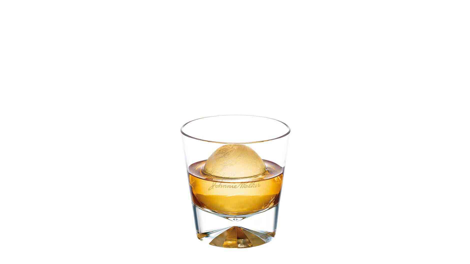 Johnnie Walker Double Black with an ice ball in a tumbler