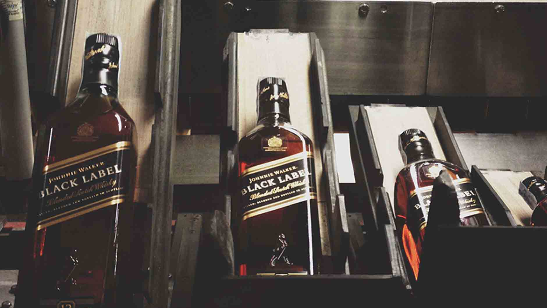 Bottles of Johnnie Walker Black Label being prepared